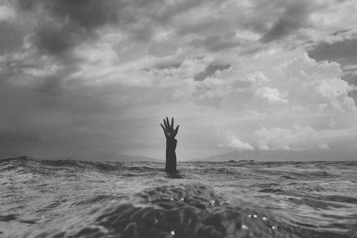 Depression: Hand sticking out of water