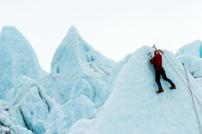 Writer In Malaysia: Man scaling ice cliffs
