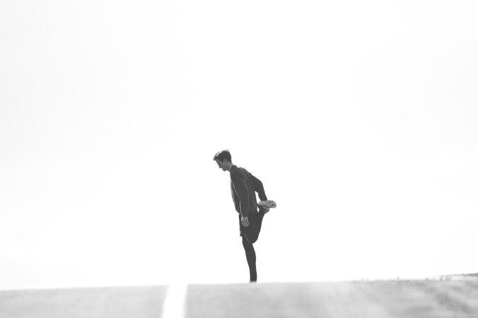 Man stretching his leg