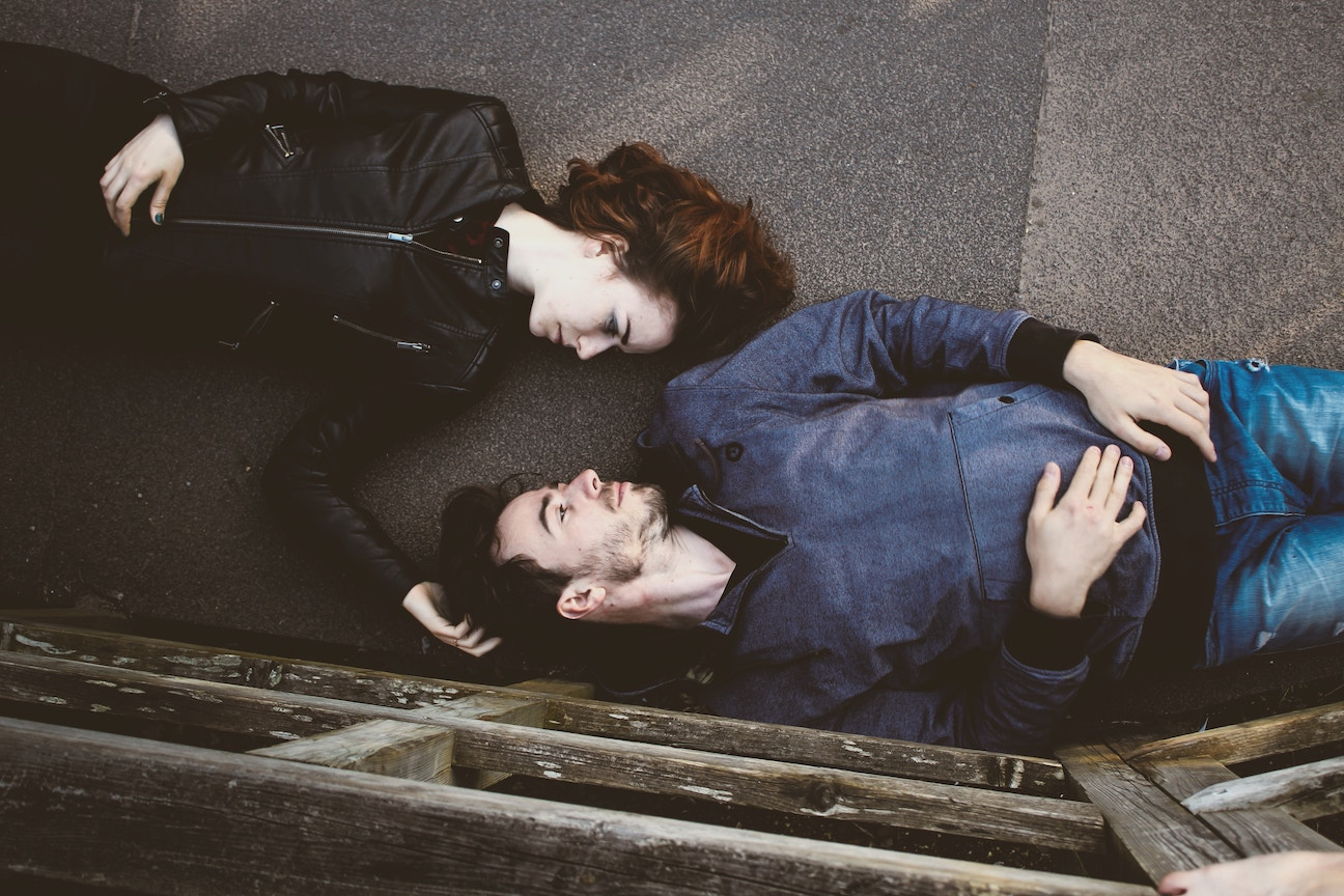 Man and woman lying down face to face