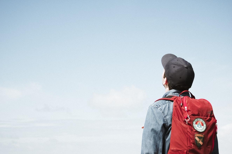 Man staring up at skies