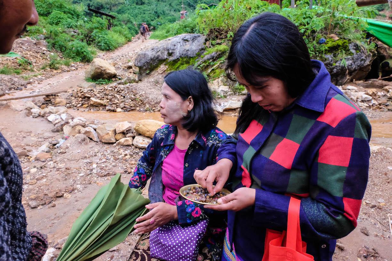 Women appraising a miner's gems