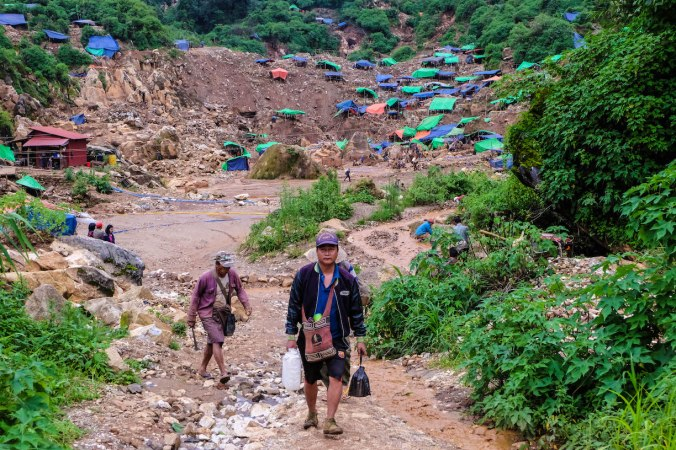 Miners finishing work at Myanmar's mines