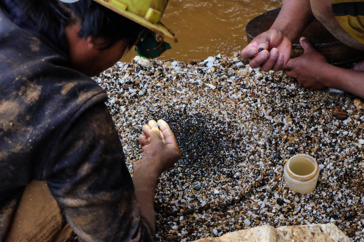 Miners finding for gems in gravel and sand