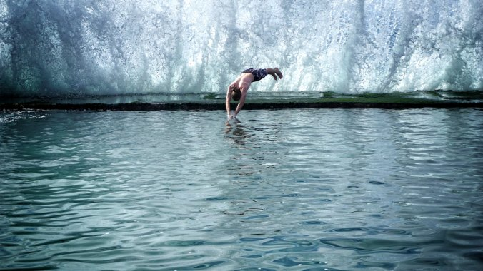 Man diving into icy waters