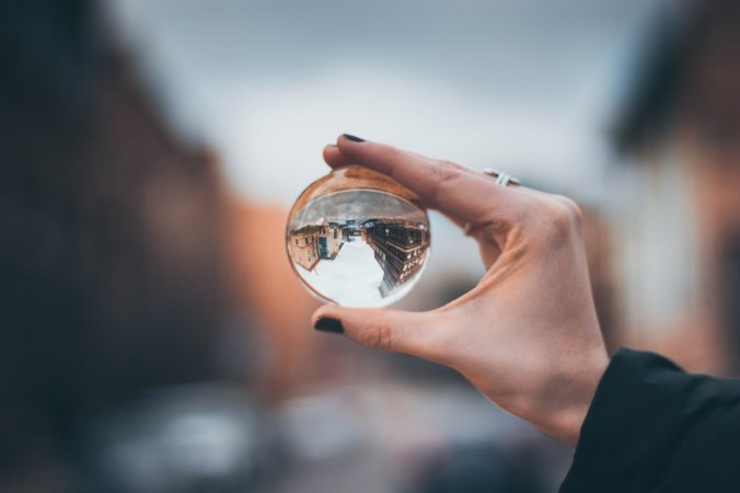 Woman holding up glass ball