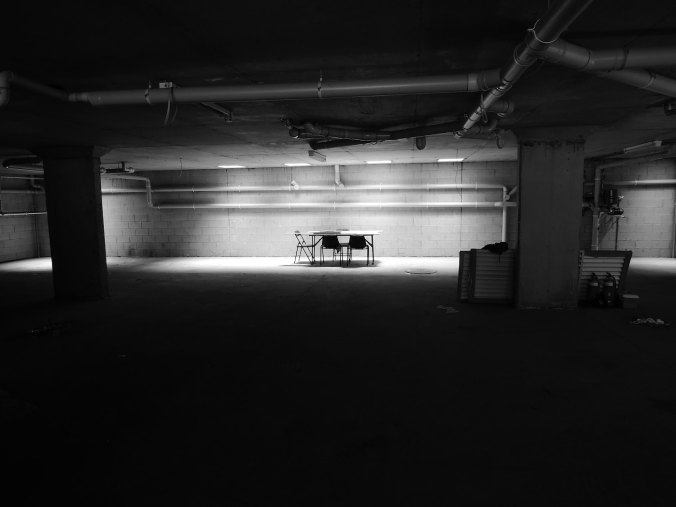 Lights shining in empty basement with a table