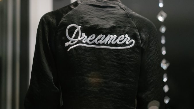 Jacket with embroidery saying 'dreamer'