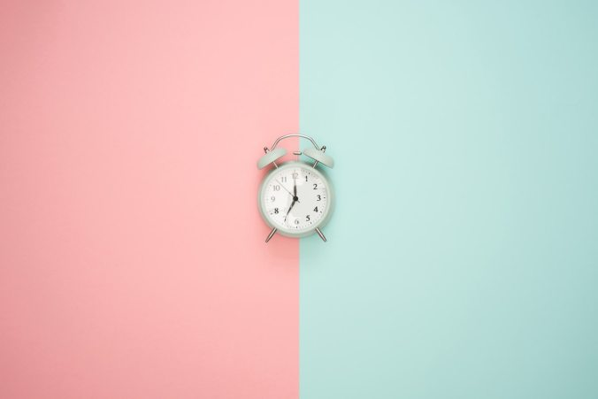 Clock on pastel pink and teal background