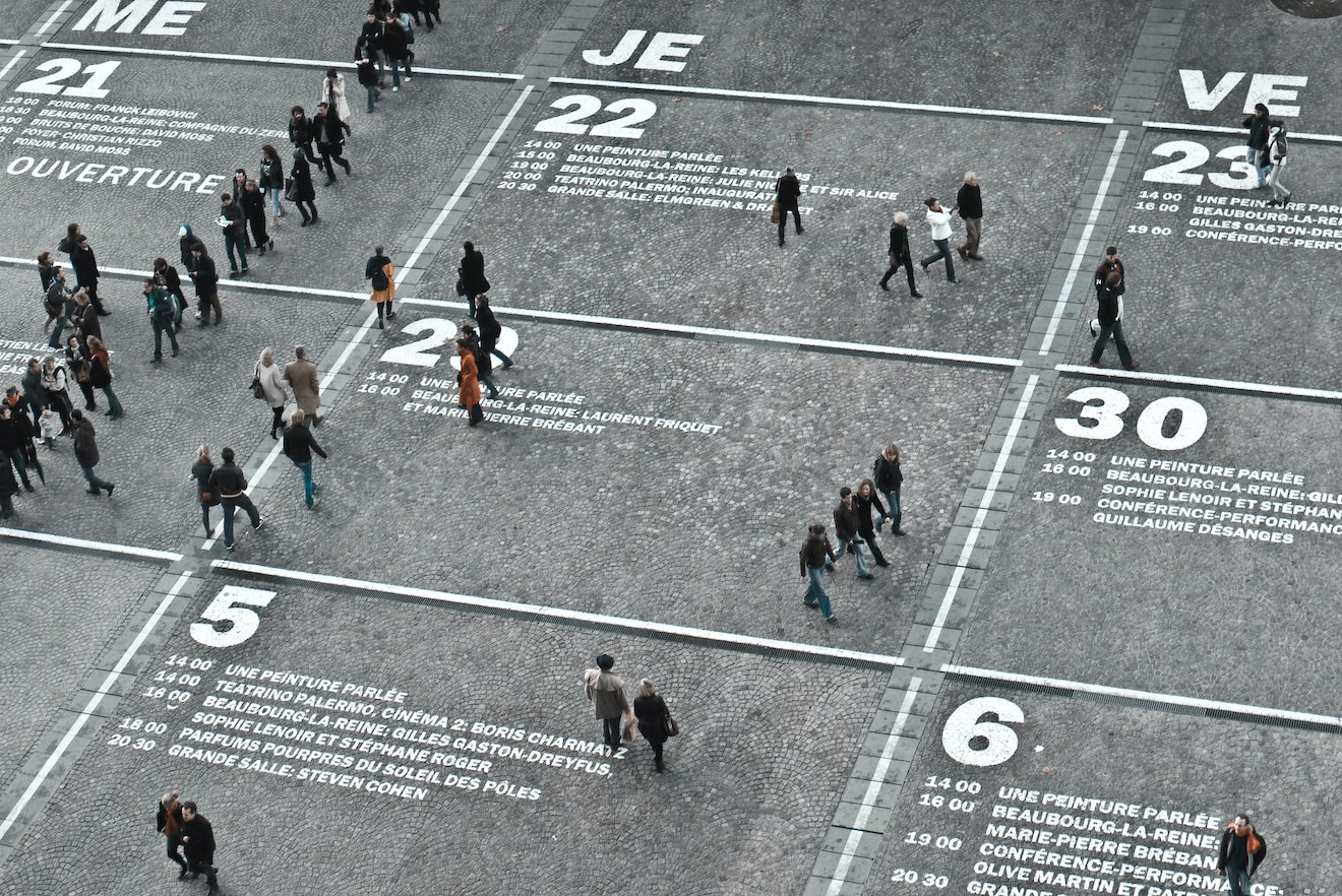 People walking on a huge calendar