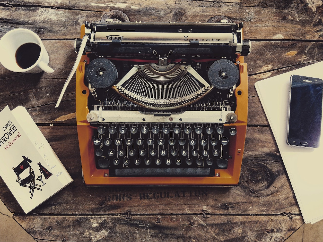 Brown typewriter on tabletop