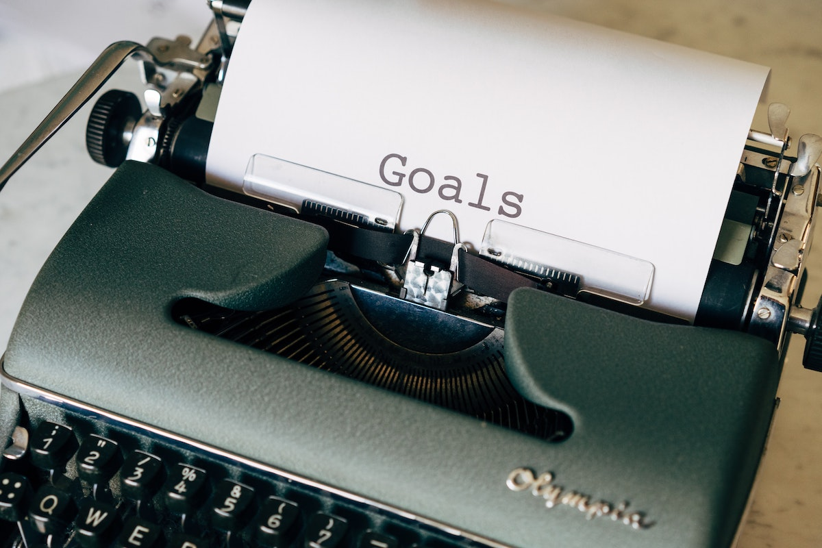 Typewriter with paper with 'goals' typed on it