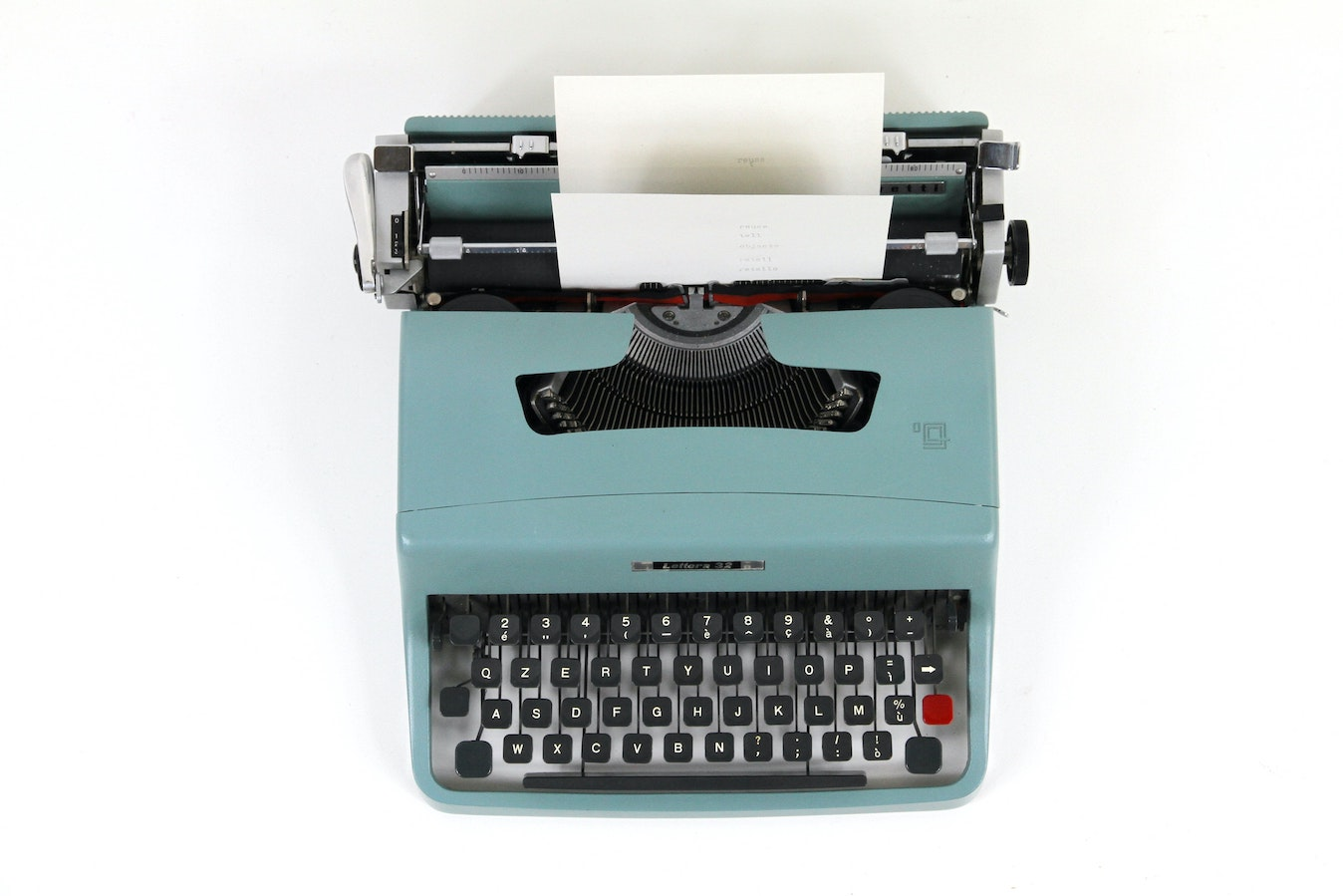 A teal typewriter