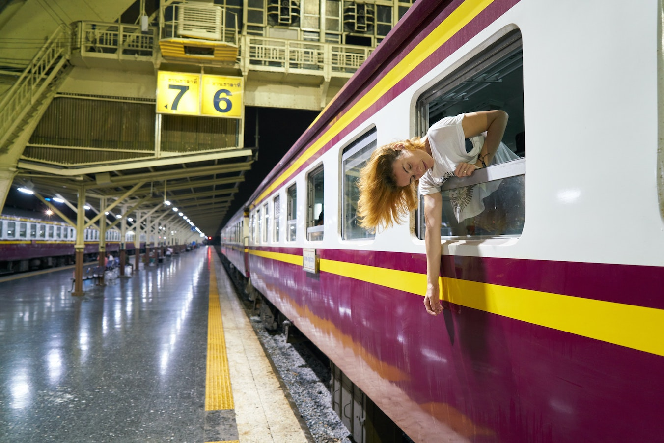 Woman sticking head out of train