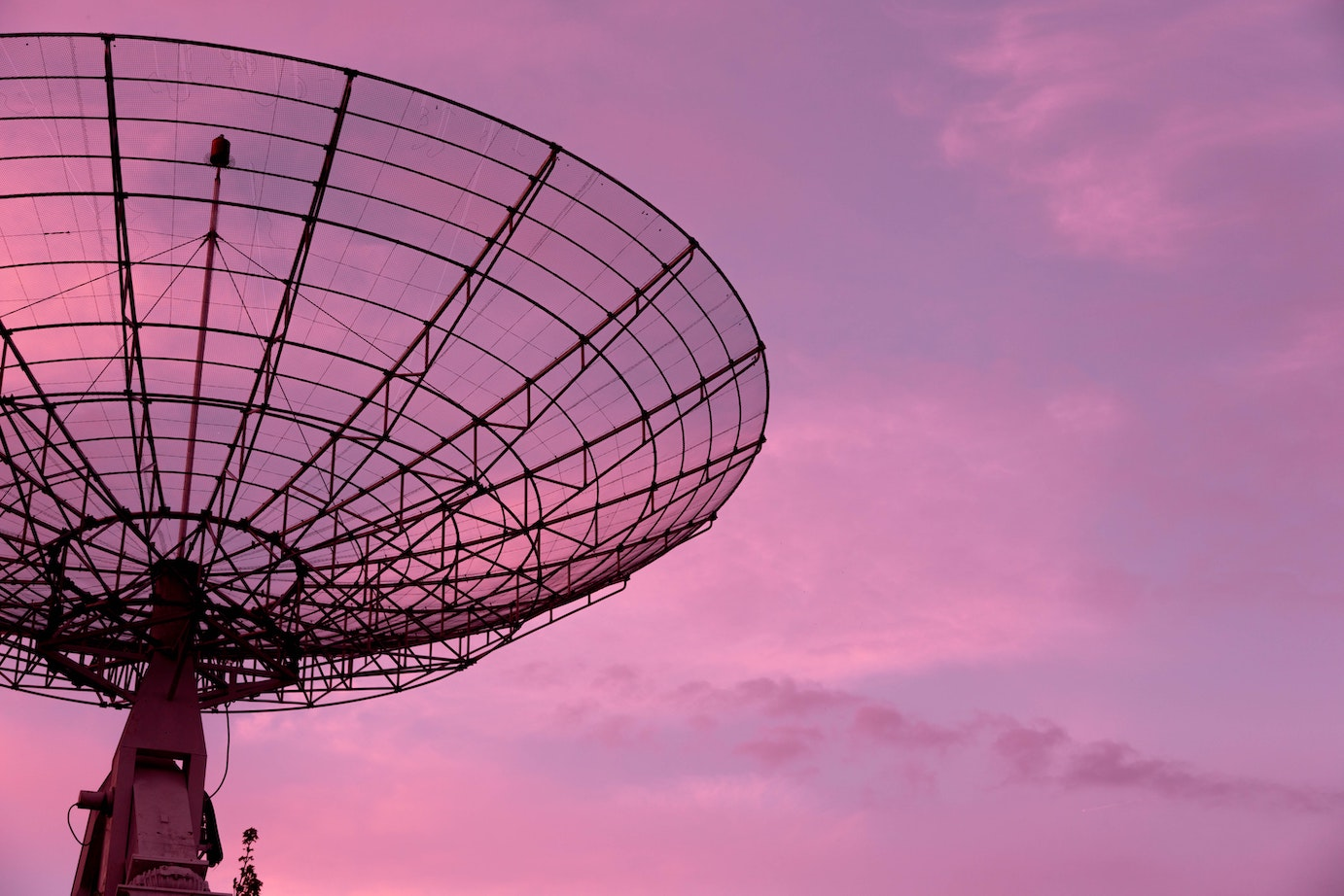 Satellite against a pink sunset