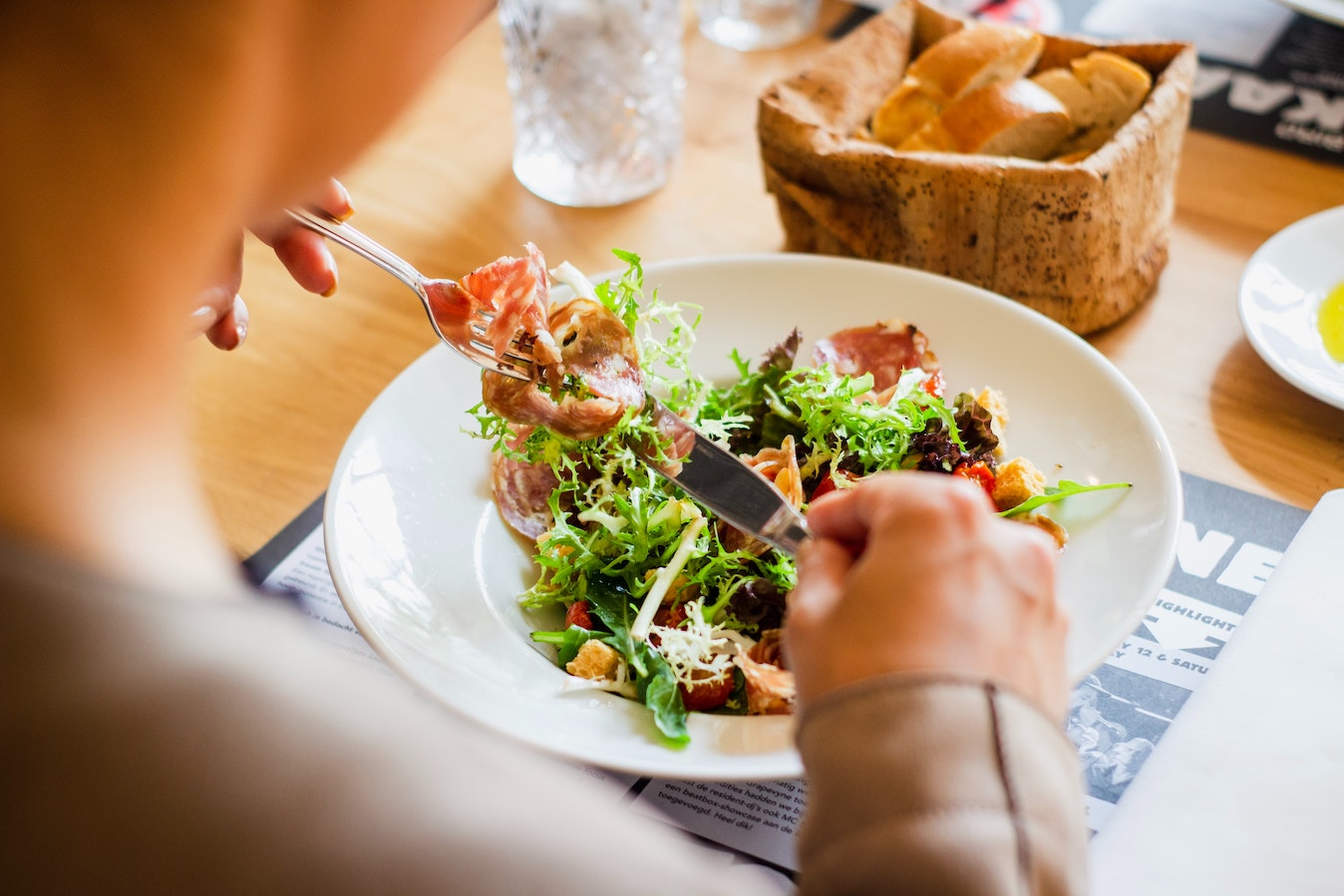 Person eating a salad