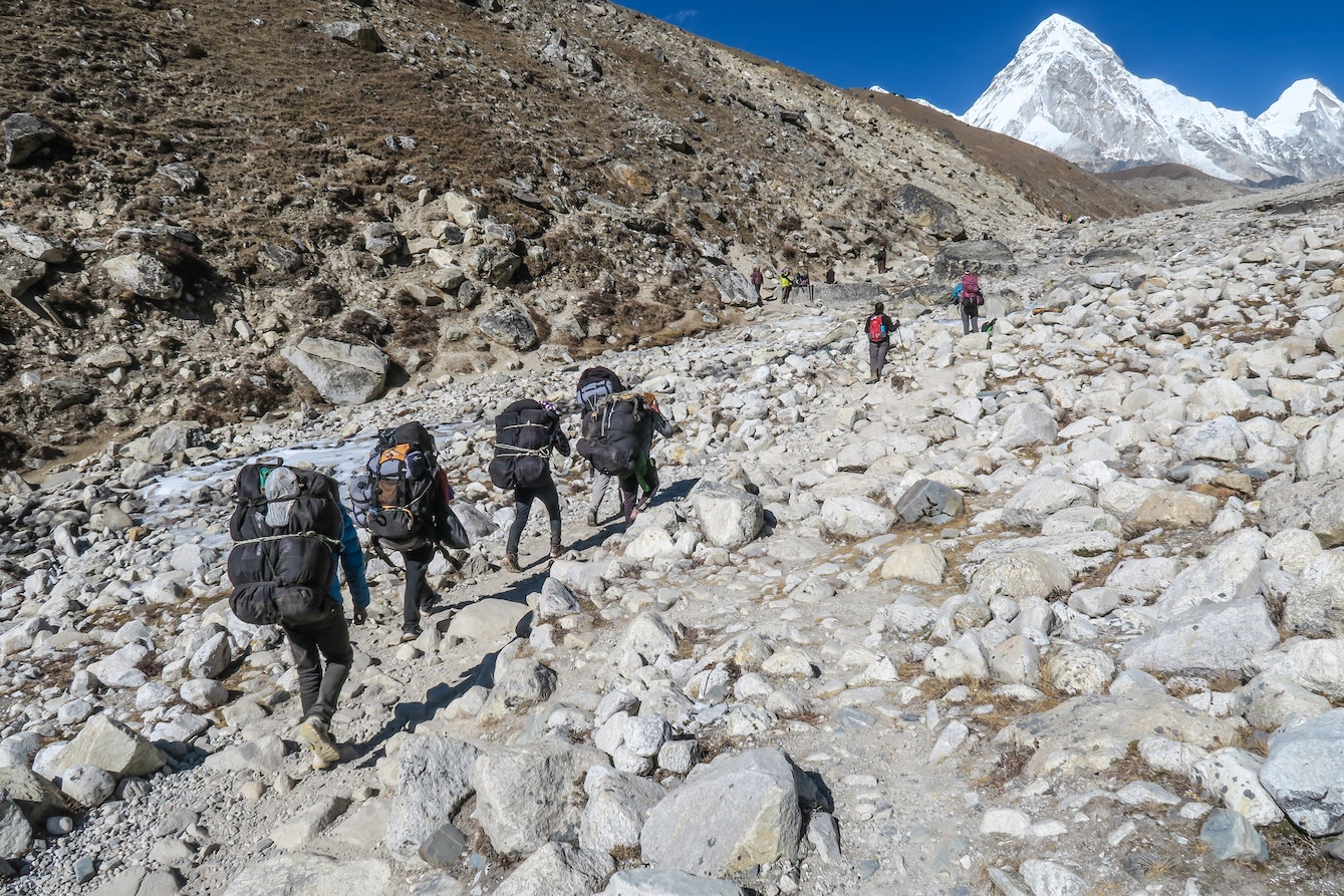 Group of people climbing Mount Everest