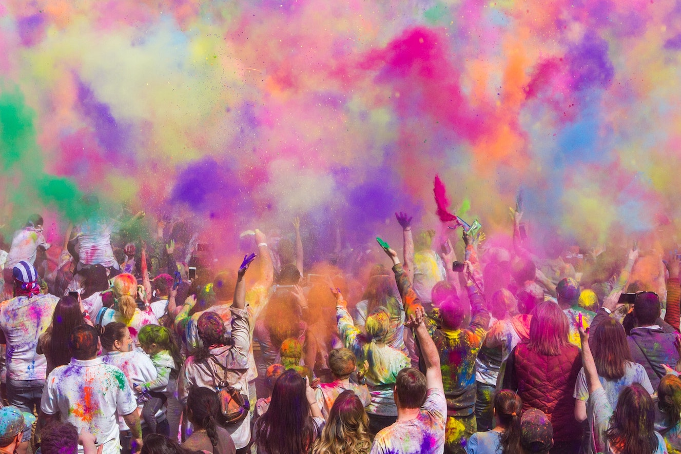 Crowd throwing coloured