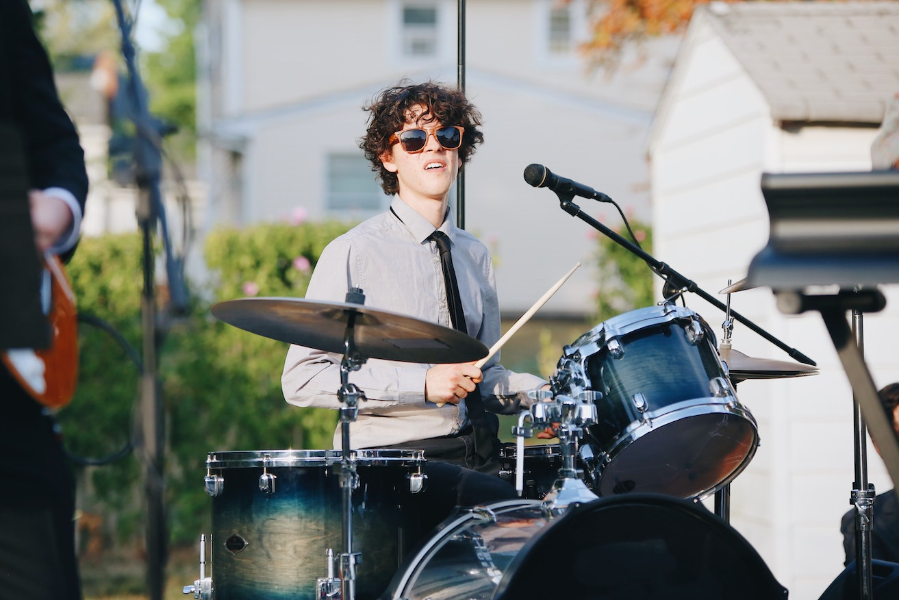A drummer with sunglasses playing