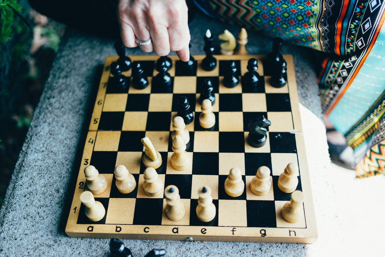 A woman playing chess