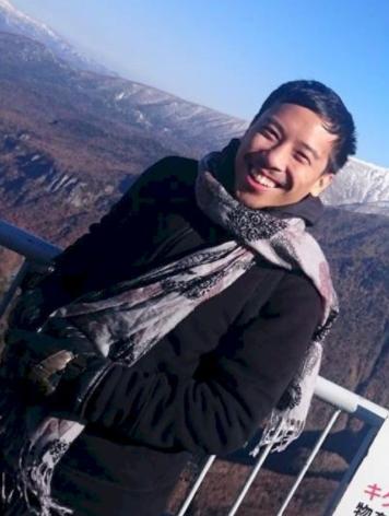 Stuart Danker standing near a mountaintop in Japan