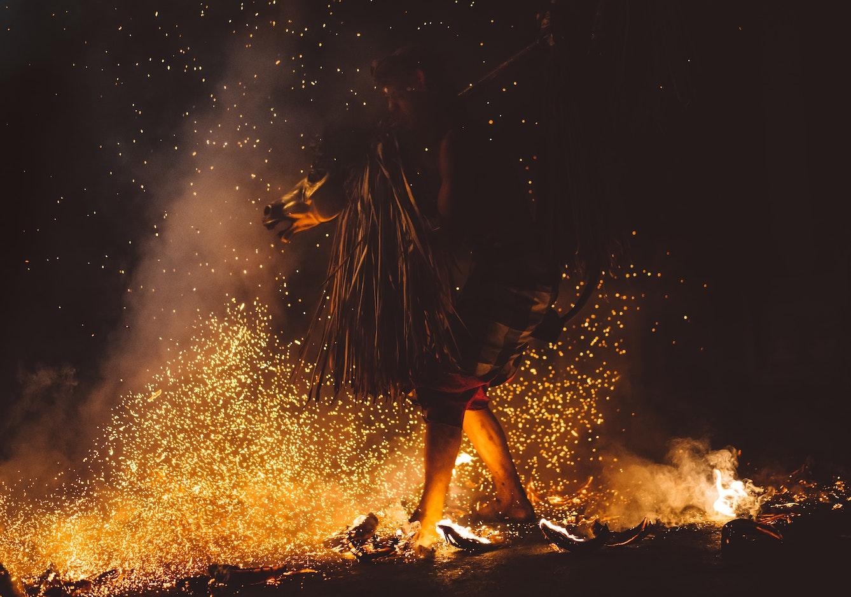 Many walking across a line of fiery coals