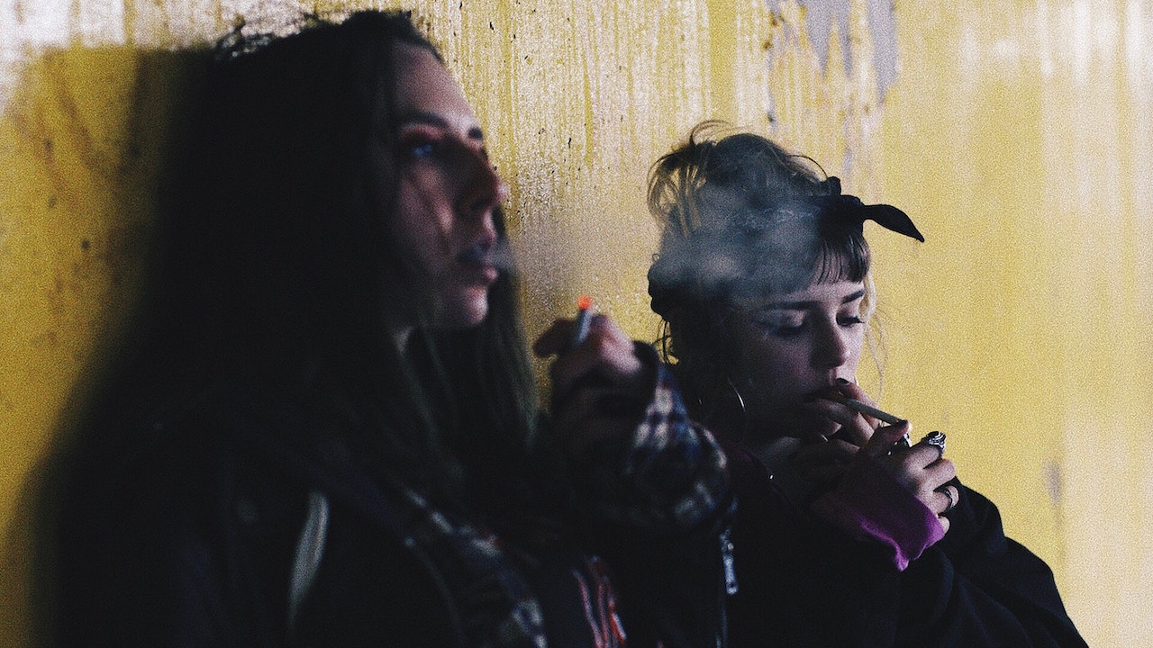 Two women smoking cigarettes