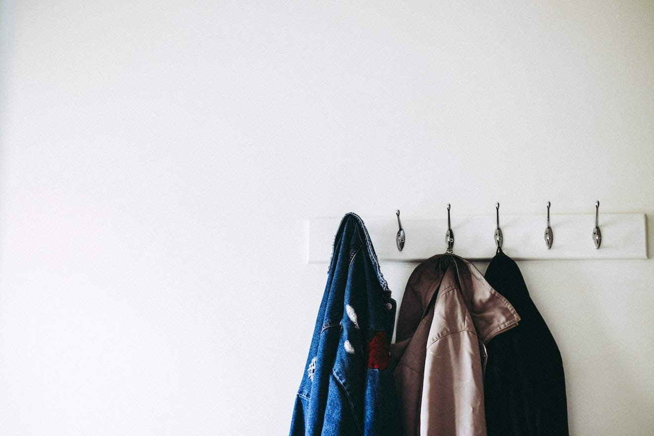 Jackets hanging off a door hanger